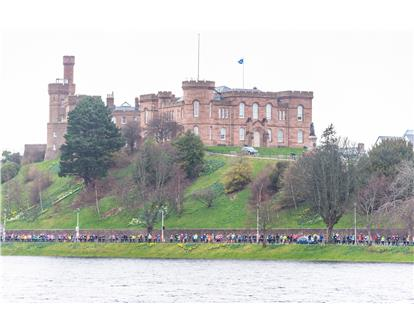 mass runners under castle inverness