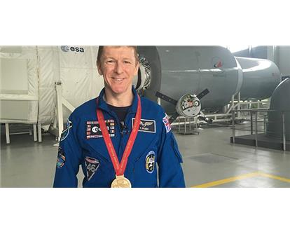 Tim Peake with medal